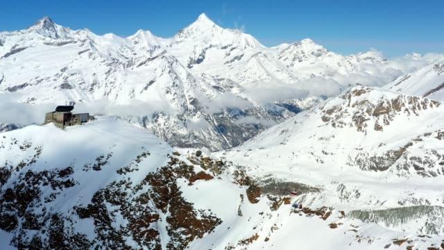 vidéos et rushes de aerial view of the zermatt ski resort in winter in switzerland - alpes suisses