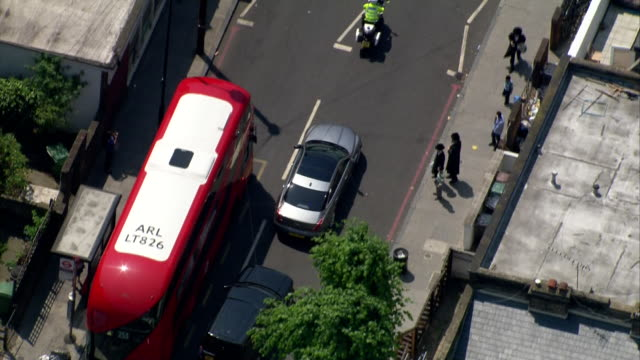 aerial view of theresa may's motorcade driving to finsbury park mosque the day after the terror attack - motorcade stock videos & royalty-free footage
