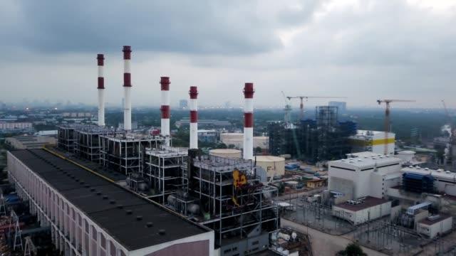 vidéos et rushes de vue aérienne de la centrale thermique et de chantier - synthpop