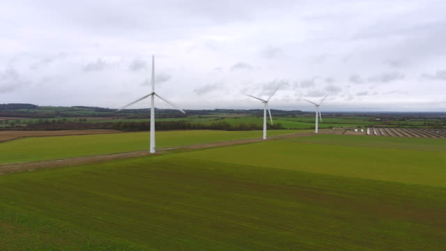 aerial view of three wind turbines - solar powered station stock videos & royalty-free footage