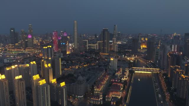 vídeos de stock, filmes e b-roll de aerial view of tianjin haihe river - tianjin