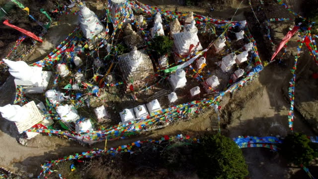 aerial view of tibetan white pagodas and religious flag in danba,sichuan,china. - lamasery stock videos and b-roll footage