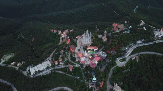 vídeos y material grabado en eventos de stock de aerial view of tibidabo - cadena de montañas