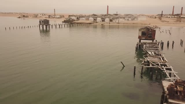 aerial view of tigres island and fishing harbour, angola - former stock videos & royalty-free footage