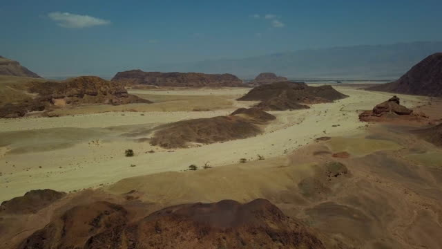 aerial view of timna valley (timna national park), surrounded by yellow sandstone mountains on three sides/arava, israel. - gulf of aqaba stock videos & royalty-free footage