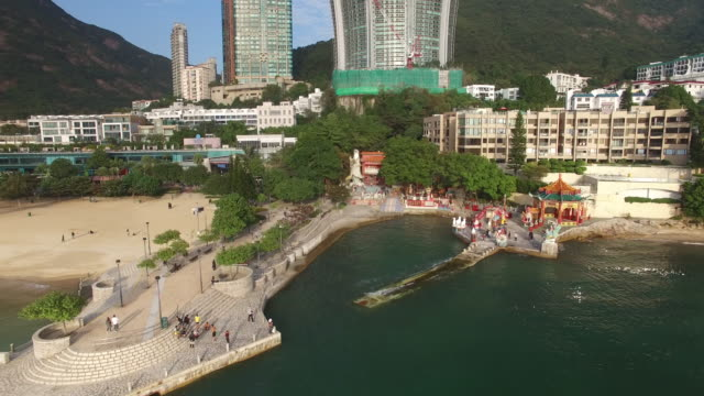 aerial view of tin hau temple at repulse bay beach on hong kong island. - hong kong island stock videos & royalty-free footage