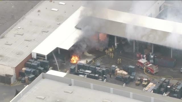 ktla aerial view of titanium fire at carson commercial structure on july 21 2015 - titanium stock videos and b-roll footage