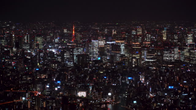 aerial view of tokyo city at night, financial district - urban sprawl stock videos & royalty-free footage