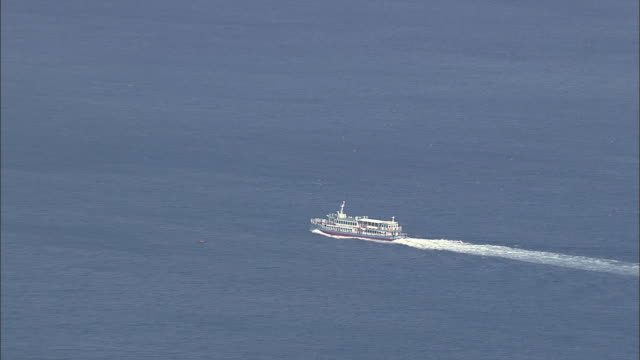 aerial view of tourboat sailing to seogwipo - tourboat stock videos and b-roll footage