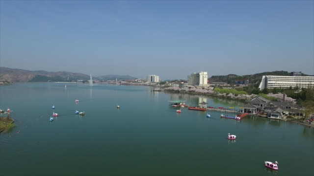 aerial view of tourboats in a lake - gyeongju stock videos and b-roll footage