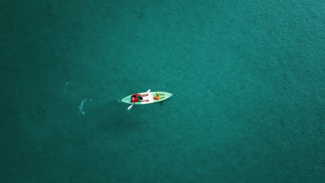 aerial view of tourist kayaking on in the sea. thailand. - turquoise colored stock videos & royalty-free footage