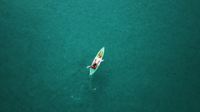 aerial view of tourist kayaking on in the sea. thailand. - kayaking stock videos & royalty-free footage