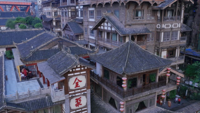 aerial view of tourists enjoying hongyadong (stilt house against a cliff) - stilt house stock videos & royalty-free footage