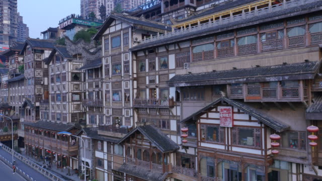 Aerial view of tourists enjoying Hongyadong (stilt house against a cliff)
