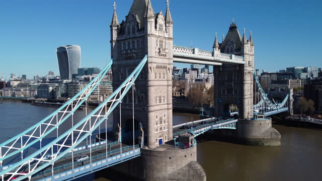 aerial view of tower bridge and the river thames. pull out and up. - pull out camera movement stock videos & royalty-free footage