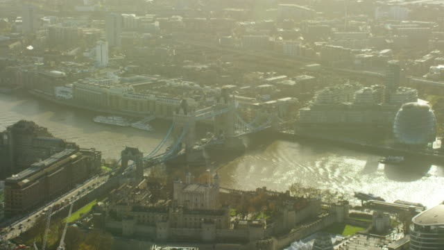 aerial view of tower bridge by river thames - tower of london stock videos & royalty-free footage