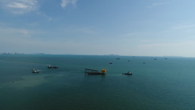 aerial view of towing ships loading marine oil rigs - towing stock videos and b-roll footage