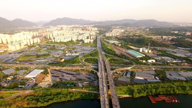 aerial view of traffic at gangil ic and cityscape - korea点の映像素材/bロール