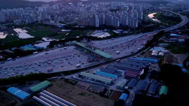 aerial view of traffic at seoul tall booth and cityscape - korea点の映像素材/bロール