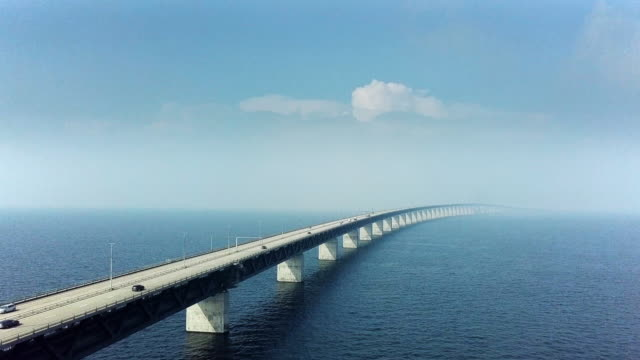 aerial view of traffic crossing oresund bridge - copenhagen video stock e b–roll