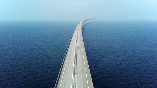 aerial view of traffic crossing oresund bridge - regione dell'oresund video stock e b–roll