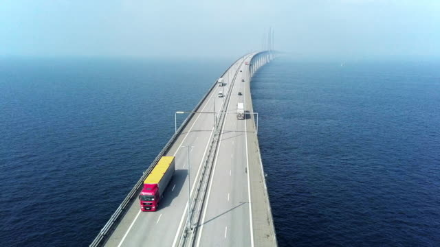 aerial view of traffic crossing oresund bridge - truck stock videos & royalty-free footage