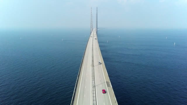aerial view of traffic crossing oresund bridge - high angle view stock videos & royalty-free footage