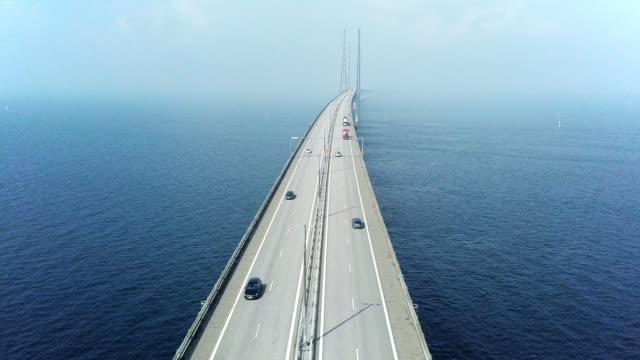 aerial view of traffic crossing oresund bridge - europe stock videos & royalty-free footage