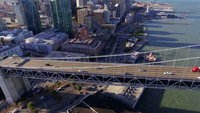 Aerial view of Traffic moving on Bay Bridge and Financial District