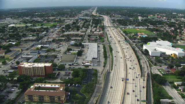 Aerial view of traffic moving on freeways in Miami.
