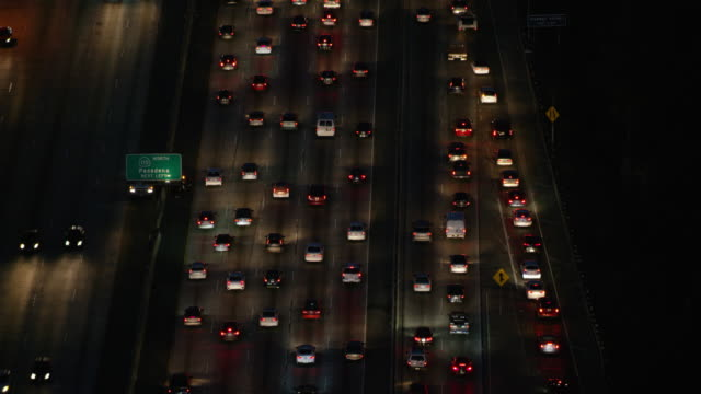 WS Aerial view of traffic moving on highway at night