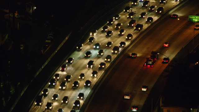 ws aerial view of traffic moving on highway at night - dividing line stock videos & royalty-free footage