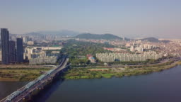 Aerial view of traffic of car driving on Dongjak bridge cross over Han river into N Seoul Tower in Seoul city, South Korea