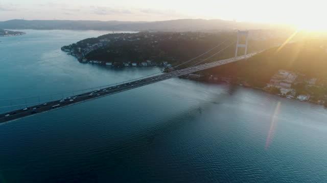 aerial view of traffic on bridge 4k- drone shots of fatih sultan mehmet bridge on istanbul bosphorus at sunrise - bosphorus stock videos & royalty-free footage