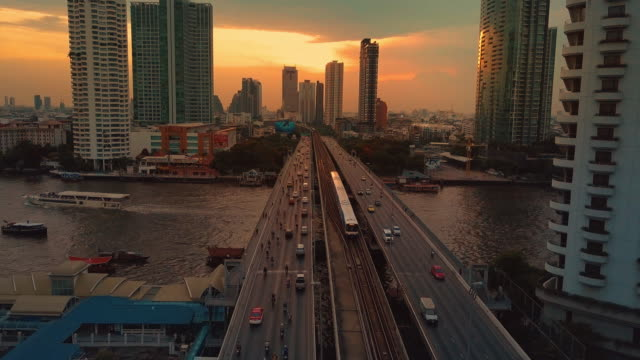 Aerial view of traffic on bridge at sunset