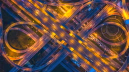 Aerial view of traffic on freeway interchange at night