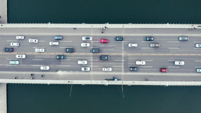 aerial view of traffic on the bridge over the river - liyao xie stock videos & royalty-free footage