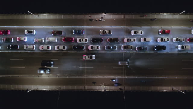 Aerial view of traffic on the bridge over the river