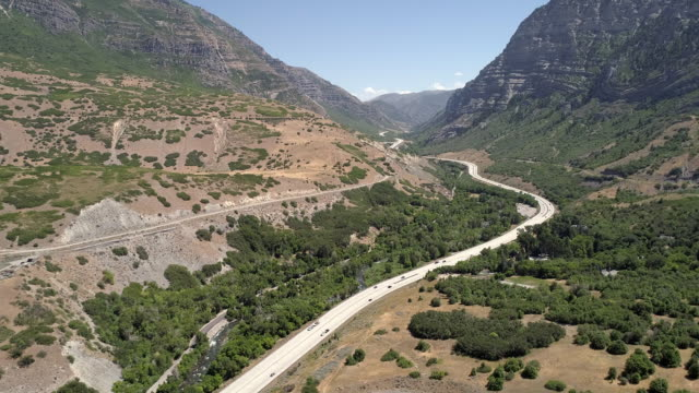 aerial view of traffic on windy road through canyon - provo stock videos & royalty-free footage