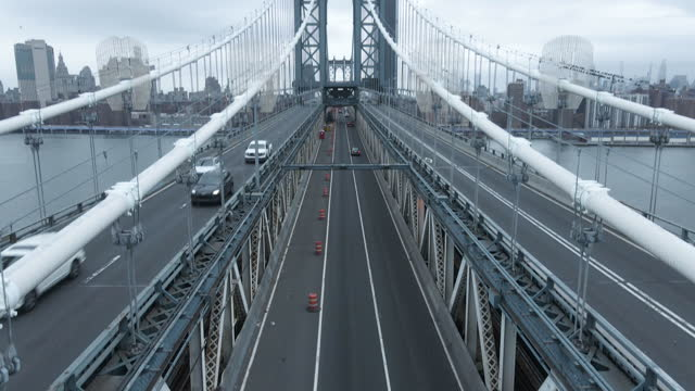 aerial view of traffic passing over new york city's manhattan bridge - cantilever stock videos & royalty-free footage