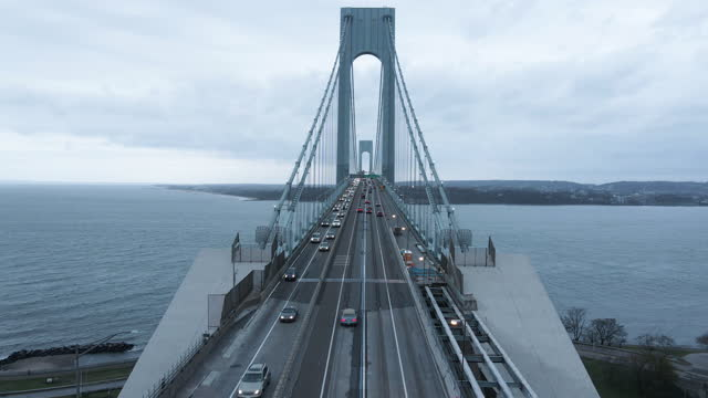 aerial view of traffic passing over new york city's verrazzano-narrows bridge - brooklyn new york stock videos & royalty-free footage