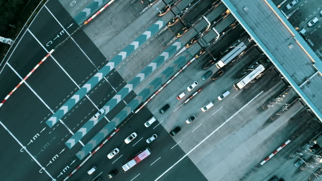 aerial view of traffic situation near fee station - building entrance stock videos & royalty-free footage
