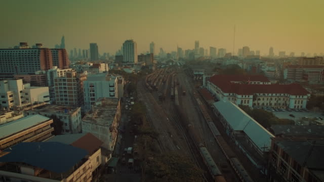 aerial view of train arriving to hua lamphong main station - shunting yard stock videos and b-roll footage