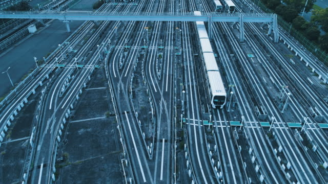 aerial view of train railways - station stock videos & royalty-free footage