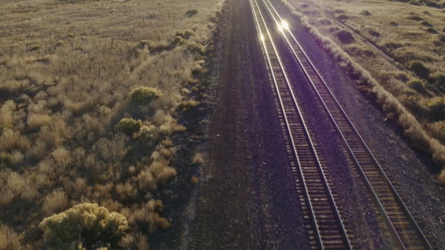 Aerial view of train tracks in desert, Gallup, New Mexico, United States