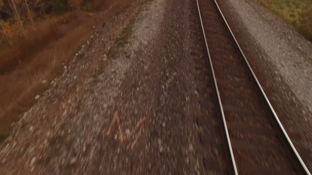 aerial view of train tracks next to alpine river - railway track stock videos & royalty-free footage