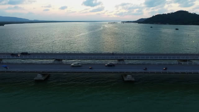 aerial view of transportation traffic on bridge over the sea - songkhla province stock videos and b-roll footage