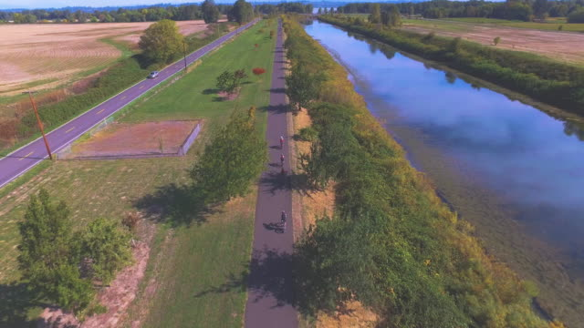 aerial view of triathletes riding bikes training for a triathlon - triathlete stock videos and b-roll footage