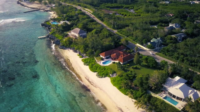 aerial view of tropical beach in caribbean - grand cayman island - caribbean sea stock videos & royalty-free footage