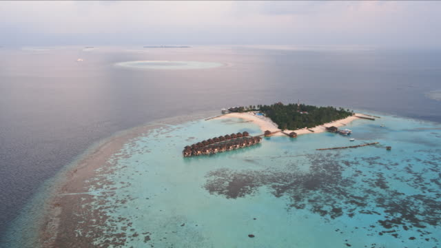 aerial view of tropical island at sunset, maldives - ari atoll stock videos & royalty-free footage